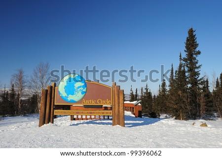 arctic circle sign in winter from dalton highway, alaska - stock photo