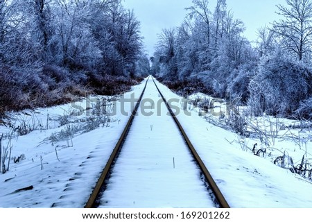Arctic Express. Railroad tracks traverse through the beauty of a northern winter wonderland  - stock photo