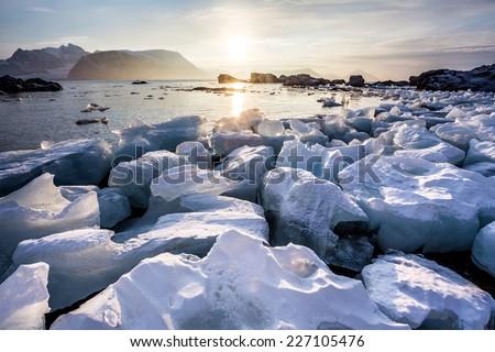 Arctic fjord landscape - ice on the shore - Spitsbergen - stock photo