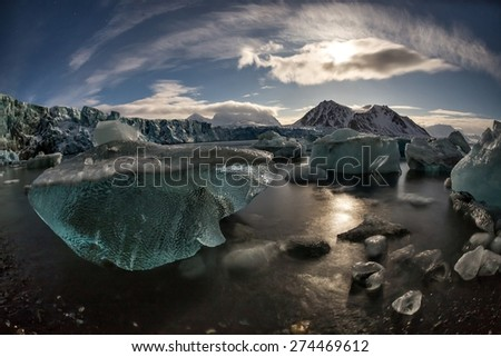Arctic glacier landscape in the moonlight - Spitsbergen - stock photo