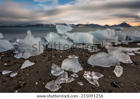 Arctic landscape with ice on the beach (long exposure) - stock photo