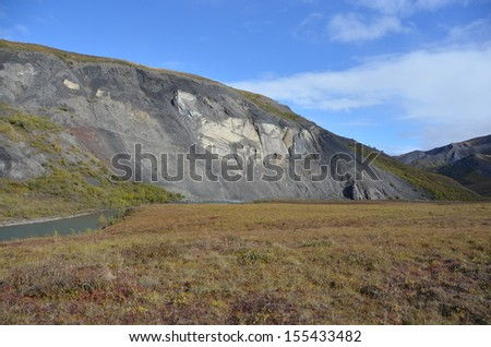 Arctic River Gorge with Mountains - stock photo