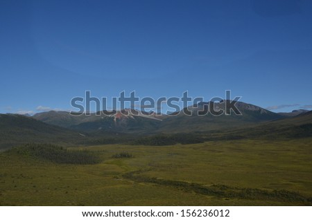 Arctic Valley with Mountain Reflection - stock photo
