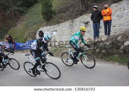 "ARDECHE, FRANCE - FEB 24: David Arroyo and Joel Zangerle riding ""LES BOUCLES DU SUD ARDECHE"" UCI Europ Tour. Matthieu Drujon won the race on February 24, 2013 in Sampzon Rock, Ardeche, France. - stock photo"