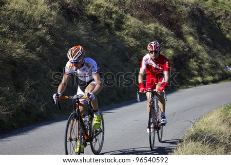 "ARDECHE, FRANCE - FEB 26: Dimitri Champion and David Moncoutie in the UCI Europ TOUR ""LES BOUCLES DU SUD ARDECHE"". Remi Pauriol wins the race on February 26, 2012 in Sampzon Rock, Ardeche, France. - stock photo"