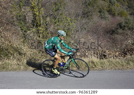 "ARDECHE, FRANCE - FEB 26: Professional cyclist Francesco Lasca riding UCI Europ TOUR ""LES BOUCLES DU SUD ARDECHE"". Remi Pauriol wins the race on February 26, 2012 in Sampzon Rock, Ardeche, France. - stock photo"