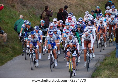 "ARDECHE, FRANCE - FEB 27: Professional racing cyclists ride UCI Europ TOUR ""LES BOUCLES DU SUD ARDECHE"" on February 27, 2011 in Sampzon Rock, Ardeche, France. - stock photo"