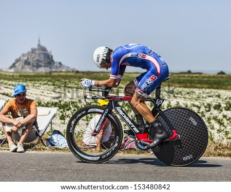 ARDEVON,FRANCE-JUL 10: The French cyclist Arnold Jeannesson from FDJ.fr Team cycling during the stage 11(time trial Avranches -Mont Saint Michel) of Le Tour de France on July 10, 2013 - stock photo