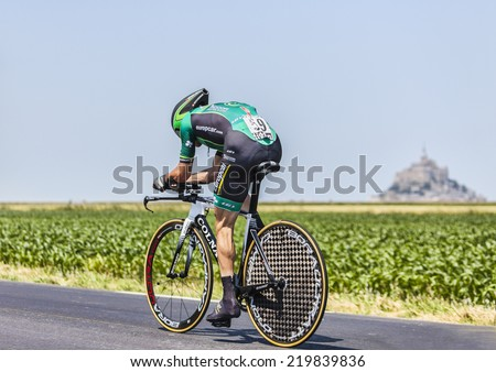 ARDEVON,FRANCE-JUL 10:The French cyclist Thomas Voeckler from Team Europcar cycling during the stage 11(time trial Avranches -Mont Saint Michel) of Le Tour de France on July 10, 2013 - stock photo