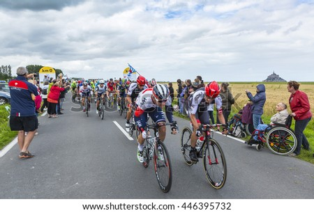 ARDEVON, FRANCE- JUL 2: The peloton (including Mark Cavendish- the winner of the stage)  taking the start of Tour de France at Km 0,  in Ardevon,France on July 2,2016.