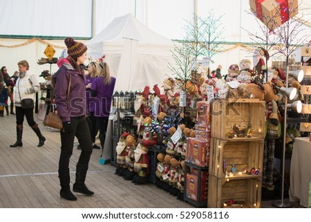 ARDINGLY, ENGLAND - DECEMBER 04, 2016: People at South of England Christmas Fair in Ardingly, West Sussex, UK; various stalls, selective focus
