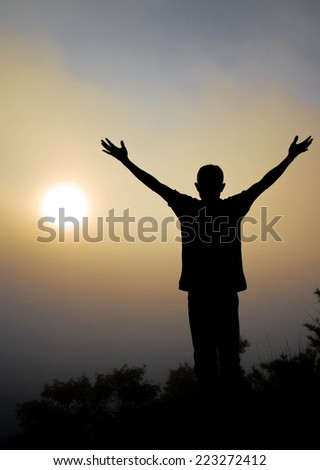 Are his hands in victory during sunrise. - stock photo