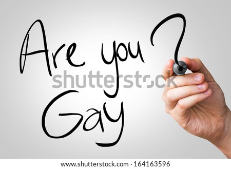 Are you gay hand writing with a black mark on a transparent board - stock photo