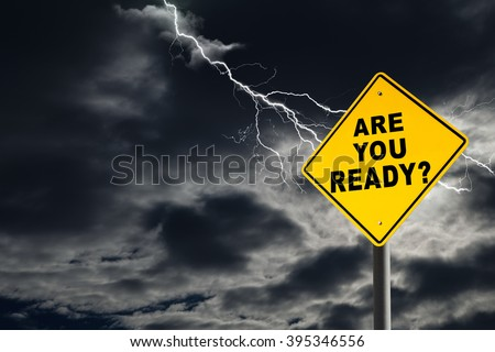Are You Ready road sign against a dark, cloudy and thunderous sky. Conceptually warning of danger ahead. - stock photo