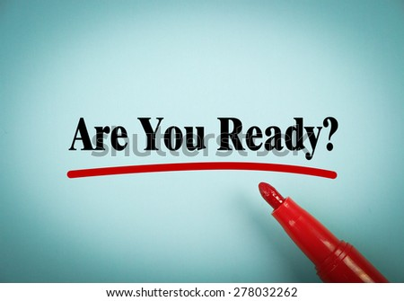 Are You Ready text is written on blue paper with a red marker aside. - stock photo
