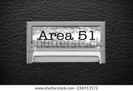 Area 51 File Drawer on leather background - stock photo