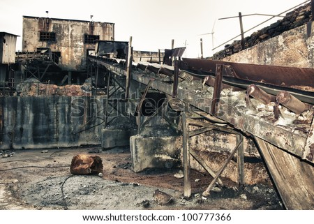 Area mining. Abandoned mine workshops former mining installations in Spain - stock photo
