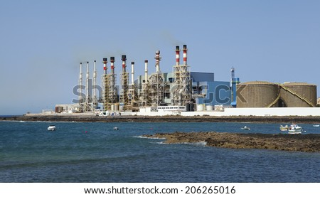 ARECIFE, LANZAROTE, SPAIN - JUNE 29, 2014: Photo showing a sea water desalination plant in Arecife on Spanish island Lanzarote, which has only 100 mm of precipitation per year. Plant runs on oil. - stock photo