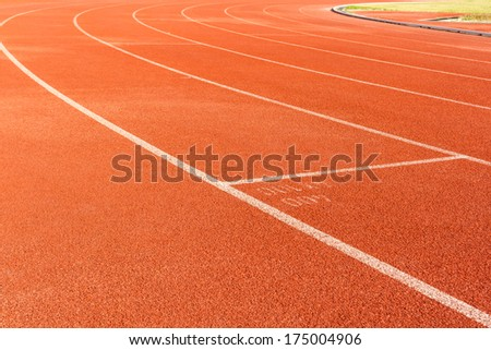 Arena sport lanes of running track with a curve.