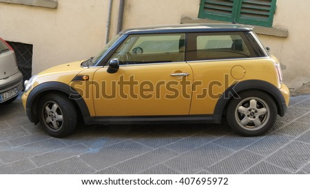 AREZZO, ITALY - CIRCA APRIL 2016: yellow Mini One car with black roof