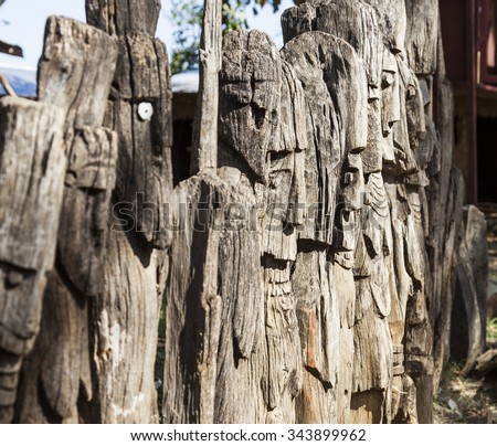 ARFAIDE (NEAR KARAT KONSO). ETHIOPIA - DECEMBER 29, 2013: Row of Wagas. Waga - carved wooden grave markers sometimes misleadingly referred to as totems.  - stock photo