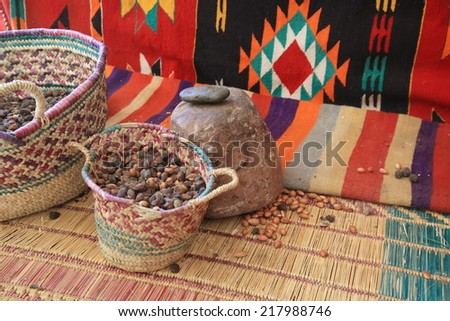 Argan Fruit or Nut in a Basket at Morocco - stock photo