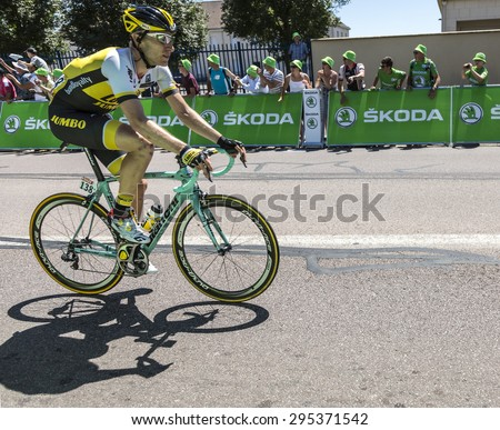 ARGENTAN, FRANCE - JUL 10: Jos van Emden of LottoNL-Jumbo Team riding in the peloton after crossing the line of the intermediate sprint in Argentan during Tour de France on 10 July 2015. - stock photo