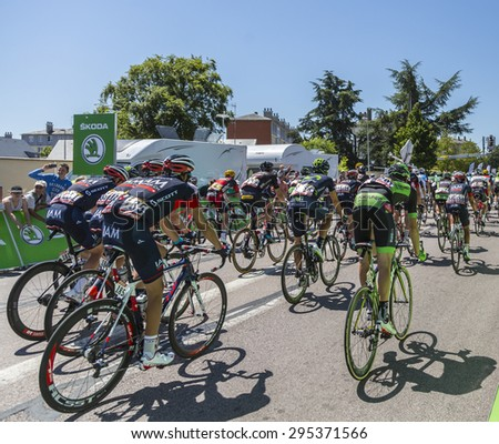 ARGENTAN, FRANCE - JUL 10: The peloton riding after crossing the line of the intermediate sprint in Argentan during Tour de France on 10 July 2015. - stock photo