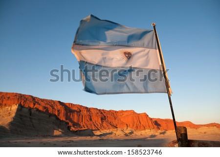 Argentina flag in the national park Ischigualasto, San Juan, Arg - stock photo