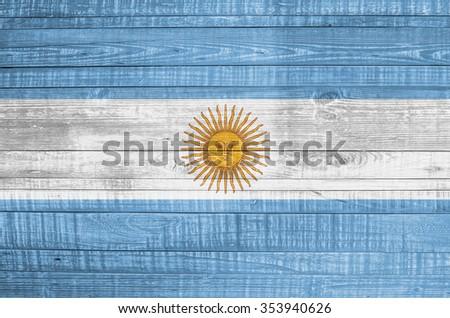 Argentina flag on wooden background - stock photo