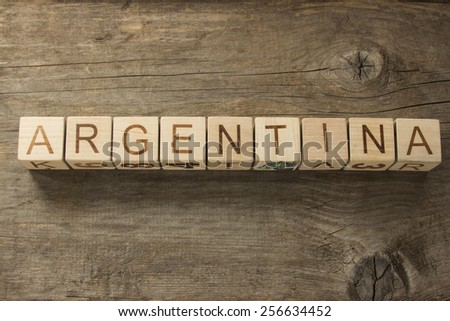 Argentina on a wooden background - stock photo