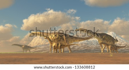 Argentinosaurus - A herd of Argentinosaurus dinosaurs walk towards more fertile vegetation to eat and water to drink. - stock photo