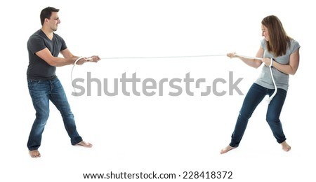 Arguing couple rope - stock photo