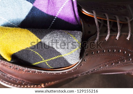 Argyle sock at the top of leather shoe - stock photo