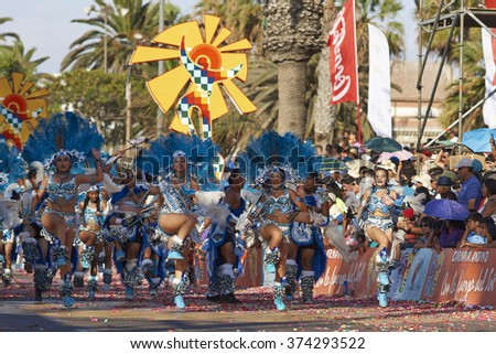 ARICA, CHILE - JANUARY 24, 2016: Tobas dancers in traditional Andean costumes performing at the annual Carnaval Andino con la Fuerza del Sol in Arica, Chile. - stock photo