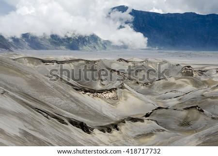Arid Landscape Defined by Volcanic Eruption at Mt. Bromo, Tengger Semeru National Park, East Java, Indonesia. - stock photo