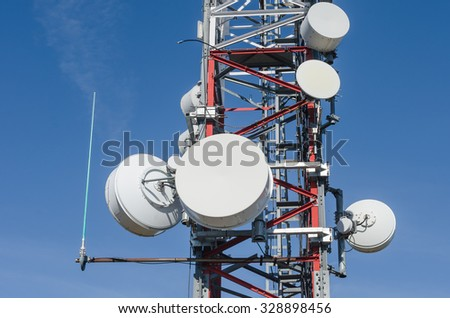 arious types of parabolic antennas and installed in a communications tower - stock photo