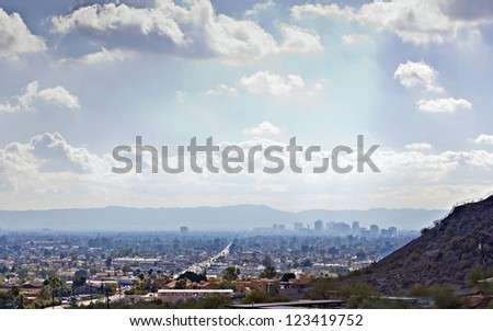 Arizona capital city of Phoenix as seen from Northern Mountain; Backlit - stock photo