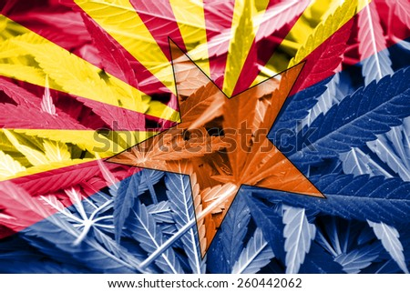 Arizona State Flag on cannabis background. Drug policy. Legalization of marijuana - stock photo
