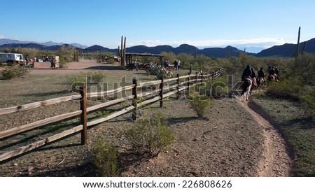 ARIZONA, USA - FEBRUARY 04, 2014: Visitors ride on the hourse back at Arizona, USA. Horseback riding is the best way to enjoy the beauty of Arizona.  - stock photo