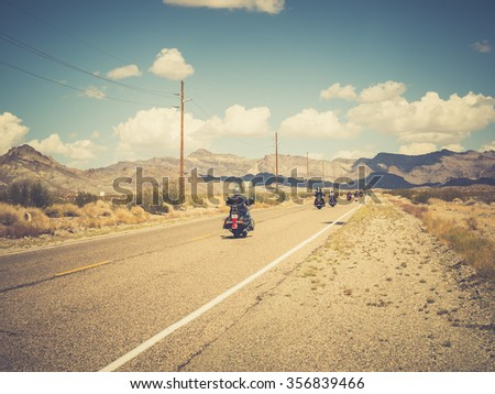 ARIZONA, USA - SEPTEMBER 05: motorbikers in historic Route 66 on September 05, 2015 in Arizona, United States. Route 66 was established on November 11, 1926. - stock photo