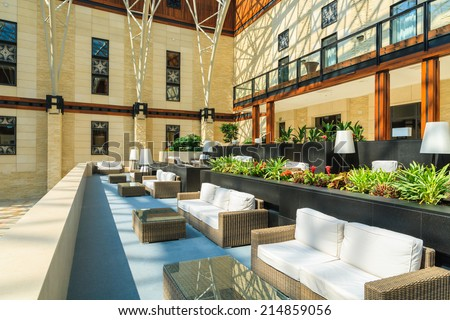 ARLAMOW HOTEL, POLAND - AUG 3, 2014: sofas in beautiful open lobby restaurant in Arlamow Hotel. This luxury resort was owned by Poland's government and is located in Bieszczady Mountains.