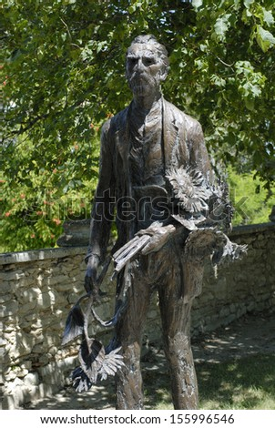 Arles, France, July. 2006: Bronze stature of painter, Vincent Van Gogh at Arles, France on July 30th. 2006, the painter holding sunflower - stock photo