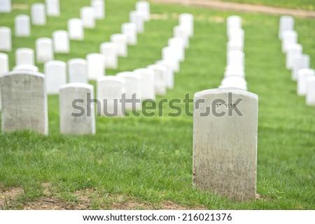 arlington cemetery graveyard white tombstones - stock photo