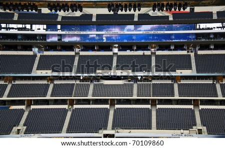 ARLINGTON - JAN 26: A view of the FOX Sports super bowl broadcast press box and triplets ring of honor in Cowboys Stadium in Arlington, Texas. Taken January 26, 2011 in Arlington, TX. - stock photo