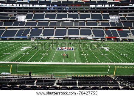 ARLINGTON - JAN 26: A view of the 50 yard line and field in Cowboys Stadium in Arlington, Texas sight of Packers Steelers Super Bowl XLV. Taken January 26, 2011 in Arlington, TX. - stock photo