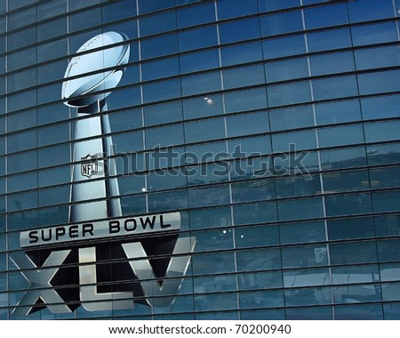 ARLINGTON - JAN 26: Preparations are underway for Super Bowl XLV. A view of the Super Bowl trophy on the side of Cowboys Stadium in Arlington, Texas. Taken January 26, 2011 in Arlington, TX. - stock photo