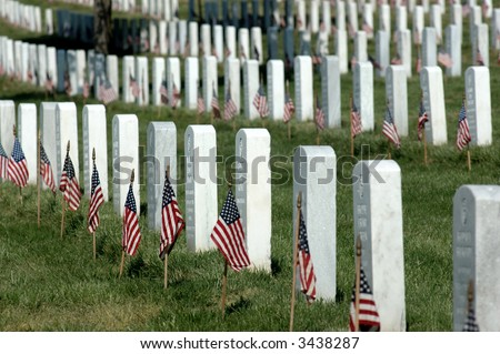 Arlington National Cemetery headstones with American Flag on each - stock photo