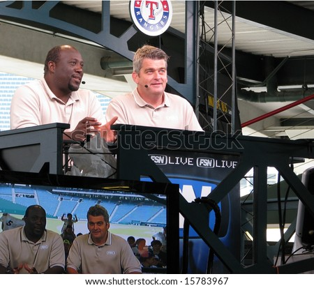 ARLINGTON, TEXAS - May 3, 3008 - Two FSN Live commentators after a Seattle Mariners and Texas Rangers game. Photo captures them live and simultaneously broadcast on television. EDITORIAL USE ONLY - stock photo