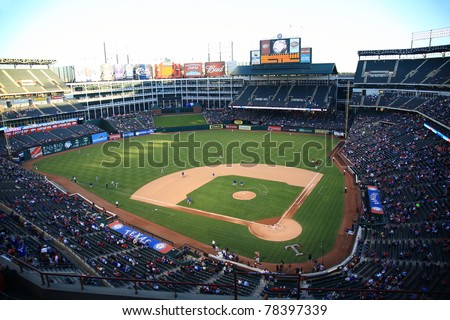 ARLINGTON, TEXAS - SEPTEMBER 27: Night game at Rangers Ballpark in Arlington on September 27, 2010 in Arlington, Texas. The stadium seats 52,419 fans, with 5,704 club seats and 126 luxury suites. - stock photo